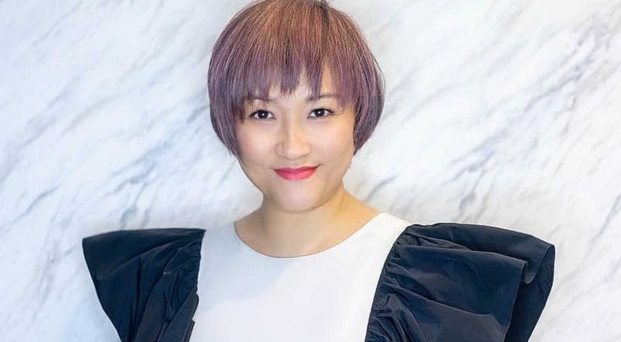 Chic Short Pixie Cut and Ash Pink Hair Colour For Mature Woman at The Urban Aesthetics