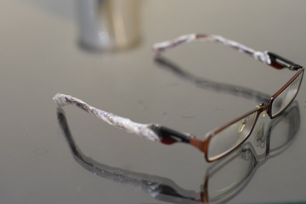 Carefully wrapping my spectacles