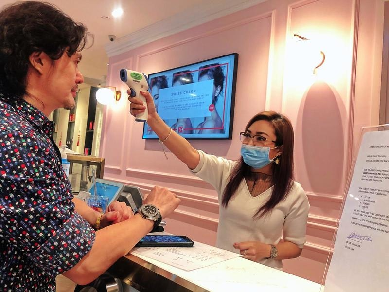 Taking Temperature at Salons During COVID-19