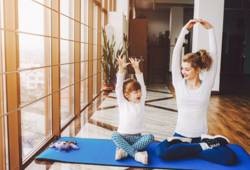 Beginner Yoga Pose for Kids Seated overhead stretch