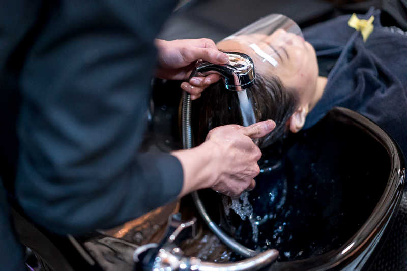 Application of Perm Lotion at Picasso Hair Studio