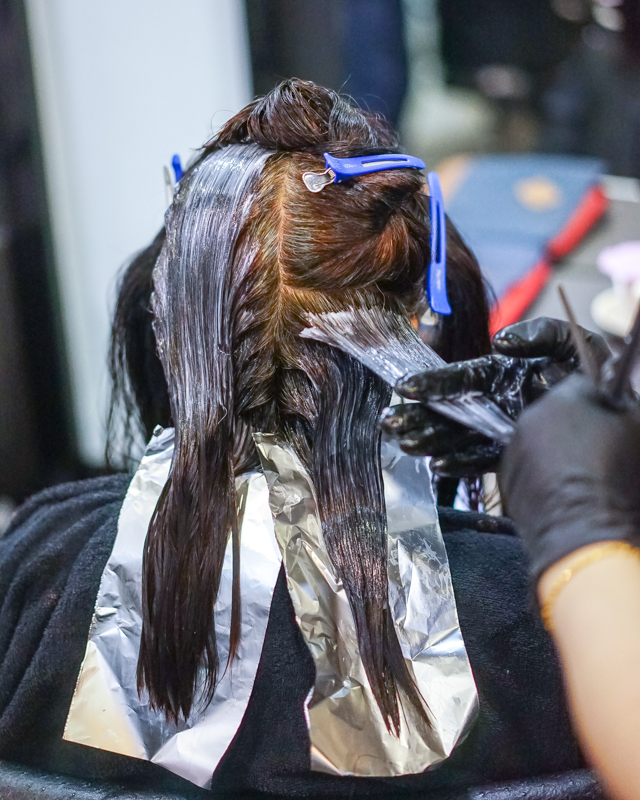 Application of Perming Lotion at Focus Hairdressing
