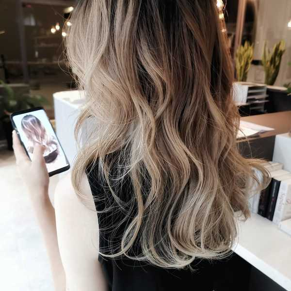 Ash-blonde ombre perfect for wavy hair or curls