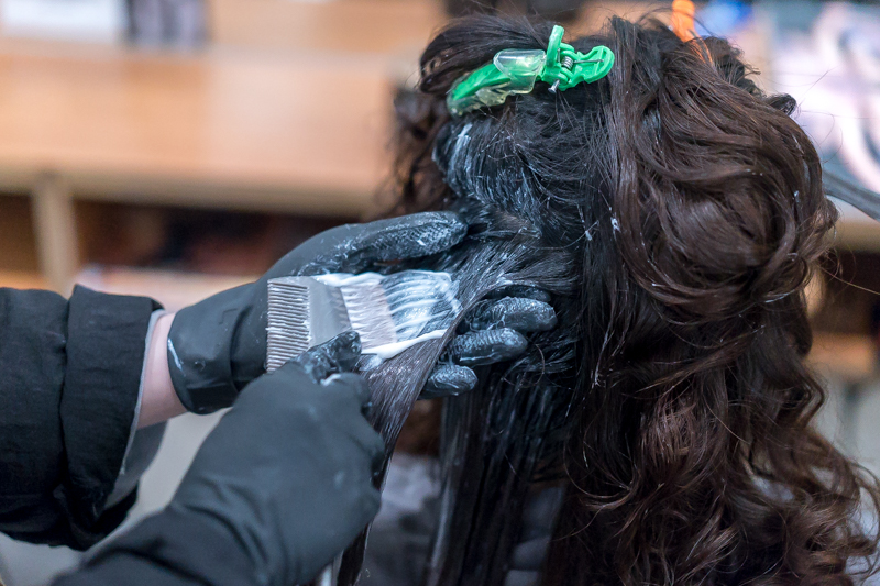 Setting Perm with Flat Iron at Pro Trim