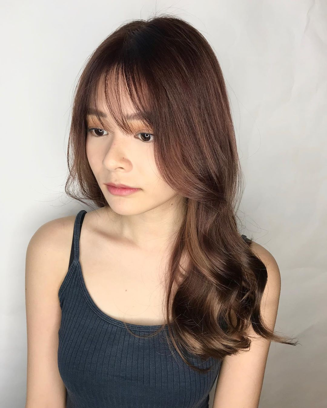 Haircut with See-Through Bangs and Hair Colour by Mode Studio