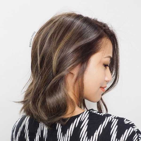Soft and natural stripe highlights by Be Salon