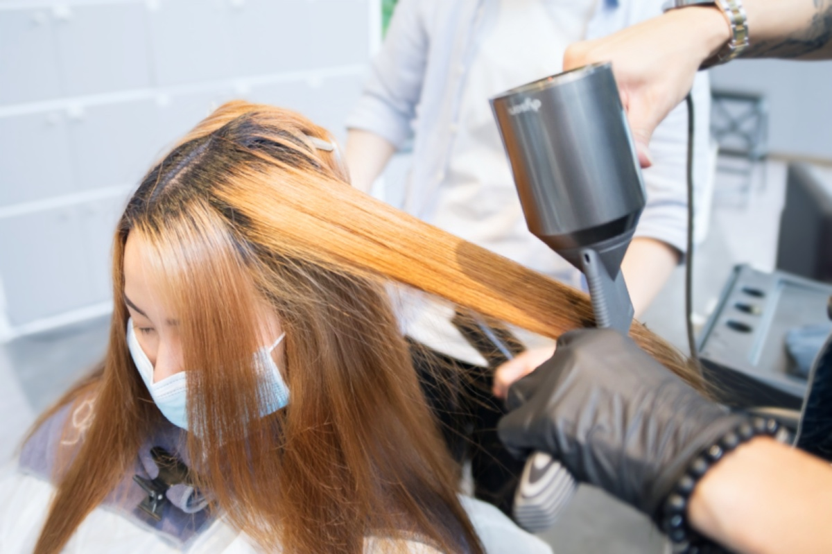 Drying and Straightening During Brazilian Blowout Treatment at 99 Percent Hair Studio